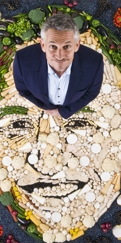 Gary Linekar standing on food mosaic
